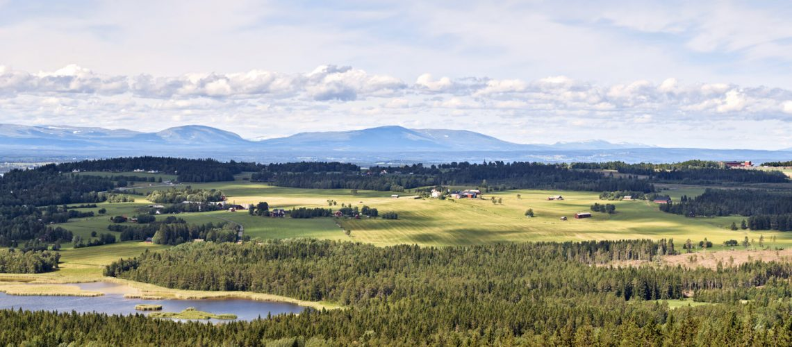 Panoramic view from the top of the mountain on Frösön in Östersund with a view of Östersund airport towards ski resort Åre and the beautiful countryside outside Östersund.